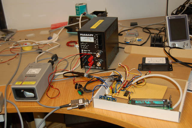 The BasicAtom Pro hidden under all the cables to LCD display, mmc card unit and sensors